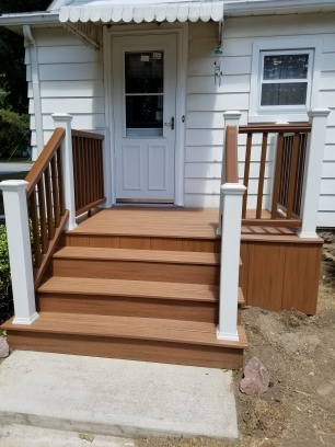 New porch, concrete, storm door and exterior door installed by Residential Remedy